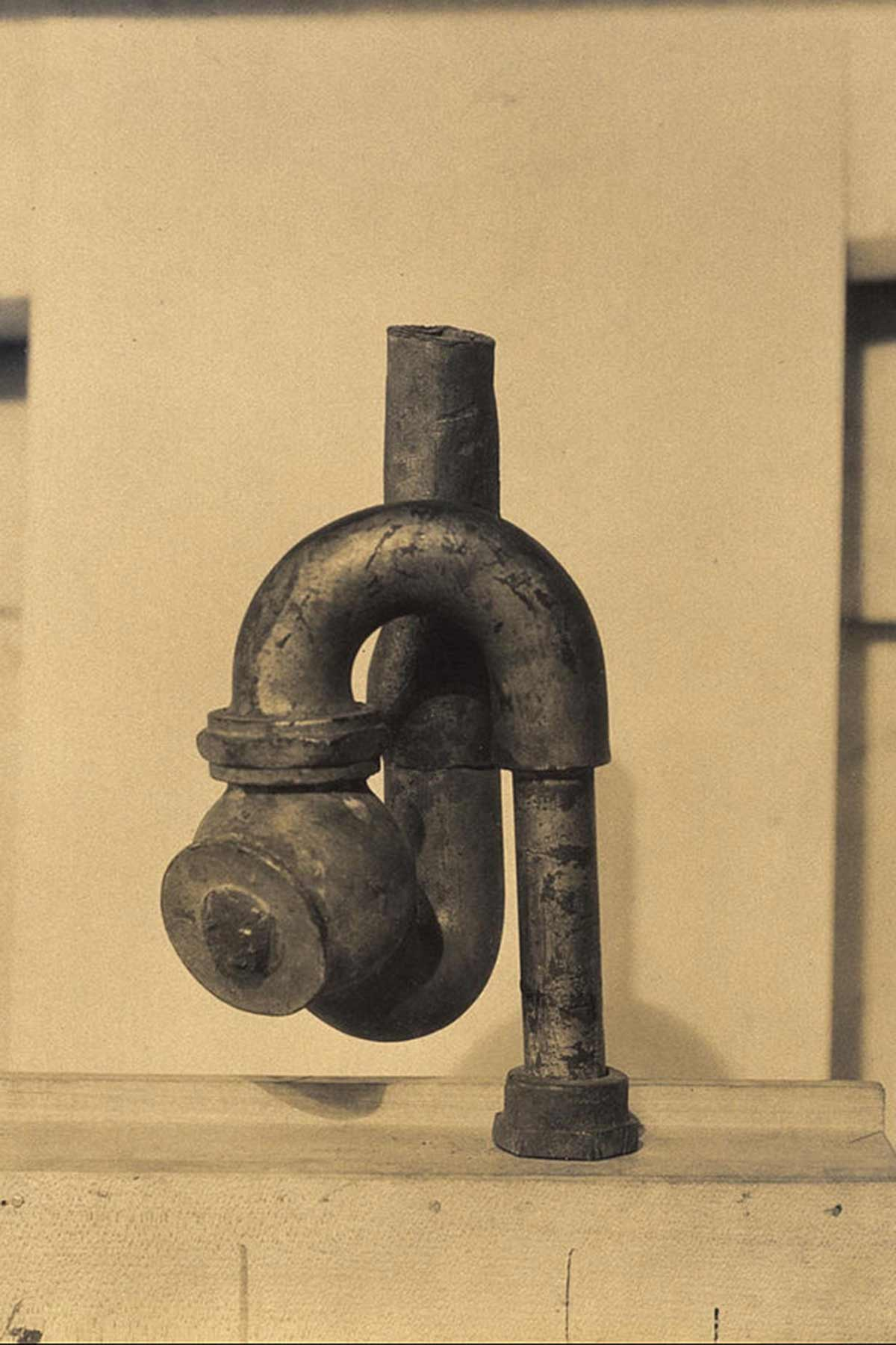 Dada sculpture of plumbing.
